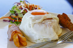 Stock Photo:Fried eggs with salad Stock Photo