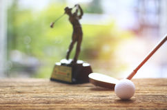 Stock Photo - golf ball and golf club on old wood table Royalty Free Stock Photography