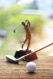 Stock Photo - golf ball and golf club on old wood table Royalty Free Stock Images