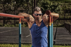 Stock Photo:Handsome healthy happy strong athlete male man exerc Royalty Free Stock Photography