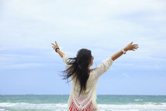 Stock Photo - Happy woman standing in sea Stock Photos