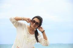 Stock Photo - Happy woman standing in sea Stock Photo