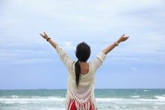 Stock Photo - Happy woman standing in sea Stock Image