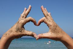 Heart made from hands Stock Photos