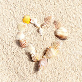 Stock Photo:heart made with shells on sand Royalty Free Stock Photos