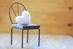 Stock Photo:Heart shaped pillow on wooden chair with vintage lo Stock Images