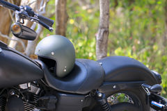 Stock Photo - helmet and glasses on the seat of a motorcycle Royalty Free Stock Images