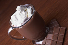 Stock Photo of Hot Cocoa. A mug of hot chocolate sits on a table Stock Photos