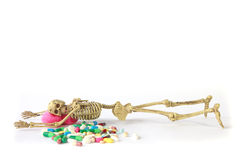 Stock Photo: Human skeleton and Overdosing Royalty Free Stock Photo