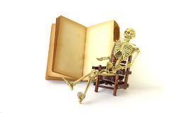Stock Photo: Human skeleton Sit on a chair With old books Stock Image
