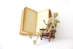 Stock Photo: Human skeleton Sit on a chair With old books Stock Photos