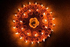 Stock photo of illuminated Diwali diya or oil lamp light, selective focus Royalty Free Stock Photo