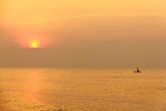 Stock Photo:Image of silhouette, Rower at sunset Royalty Free Stock Photo