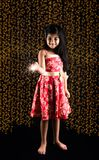 Stock photo of indian little girl holding fulzadi or sparkle or fire cracker on diwali night. Stock photo of indian little girl celebrating diwali with burning stock photography