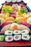 Stock Photo of Japanese Food;. Japanese Food, Assorted Menu Fuji of Sushi, and Maki in Wooden Boat Sashimi Stock Image