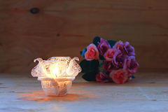 Stock Photo:Jar candle holder on a golden background Stock Images