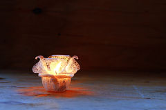 Stock Photo:Jar candle holder on a golden background Stock Photography