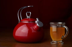 Stock Photo of a kettle and a cup of tea Royalty Free Stock Photography