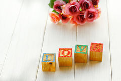Stock Photo: Love message written in wooden blocks. Royalty Free Stock Photography