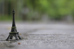 Stock Photo:Miniature Eiffel-tower with defocused of field in b Royalty Free Stock Photography