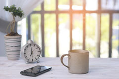 Stock Photo:Morning coffee, coffee on wood table and nature bac Stock Image
