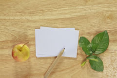 Stock photo Note paper with apple on wood background Stock Photos