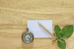 Stock photo Note paper with vintage watch on wood background Royalty Free Stock Photo