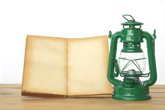 Stock Photo:Notebooks and lantern decorative on wood background Stock Images