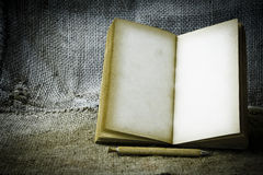 Stock Photo:old book open blank pages, empty yellow paper on da Royalty Free Stock Image