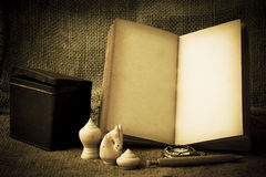Stock Photo:old book open blank pages, empty yellow paper on da Royalty Free Stock Photo