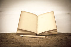 Stock Photo:old book open blank pages, empty yellow paper Stock Photos