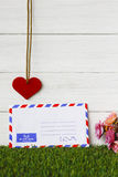 Stock Photo:Old envelope on wooden background Royalty Free Stock Images