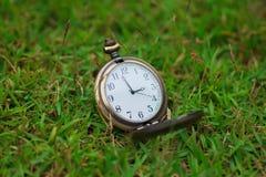 Stock Photo - Old vintage pocket clock on grass Stock Image