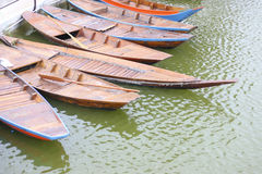 Stock Photo:Old wooden row boat on water Stock Images