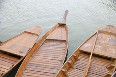 Stock Photo:Old wooden row boat on water Stock Photos