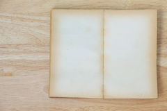 Stock Photo:Open Book blank on old wood background Royalty Free Stock Images