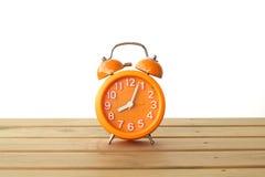 Stock Photo:Orange alarm clock isolated on white background Royalty Free Stock Photo