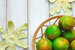 Stock Photo - Orange fruit on a wooden white. Royalty Free Stock Images