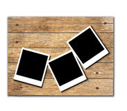 Stock Photo:Polaroid photo frames on old wooden background Stock Photography