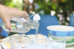 Stock Photo:Pouring water from bottle into glass Stock Photo