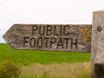 Stock Photo - public footpath wooden sign outside leading way co. Public footpath wooden sign outside leading way country Royalty Free Stock Images