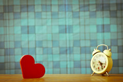 Stock Photo:Red wooden heart on a wooden background with boke b Stock Photos