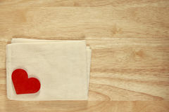 Stock Photo:Red wooden heart on a wooden background Royalty Free Stock Images