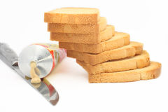 Stock photo of rusk stack. Rusk stack with mustard tube and knife Stock Photo