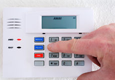 Stock Photo: Setting the Alarm System