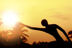 Stock Photo:The silhouette of a statue style pose, could a conc Royalty Free Stock Photos