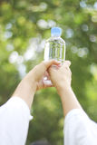 Stock Photo:Soft focus of happy girl holding in hand bottle of Stock Photo