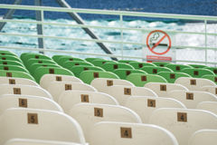 Stock Photo - stadium seats no smocking selective focus Stock Photos