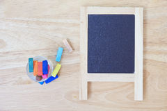 Stock Photo:Still life with empty blackboard and colored chalks Stock Images