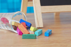 Stock Photo:Still life with empty blackboard and colored chalks Royalty Free Stock Photography